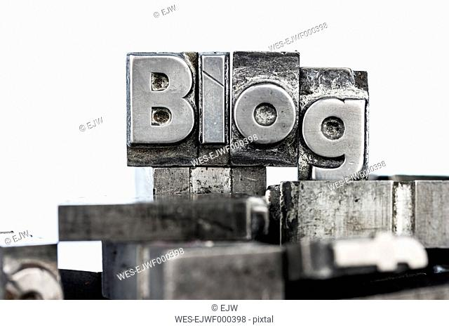 Old metal types forming the word blog