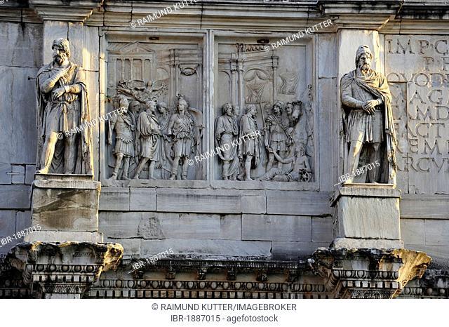 Statue of a Dacian prisoners and attic reliefs on the Arch of Constantine, Piazza del Colosseo, Rome, Lazio, Italy, Europe
