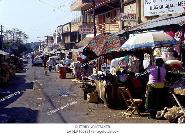 Town street market. Stalls. Umbrellas