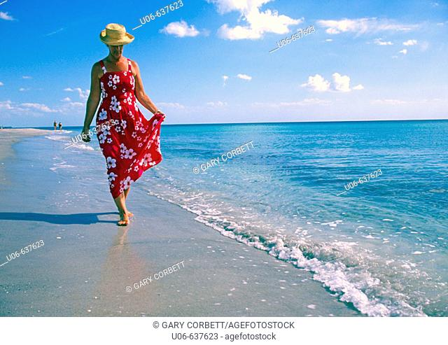 Woman in a nice dress walking, Casperson beach at Venice, Florida (USA)