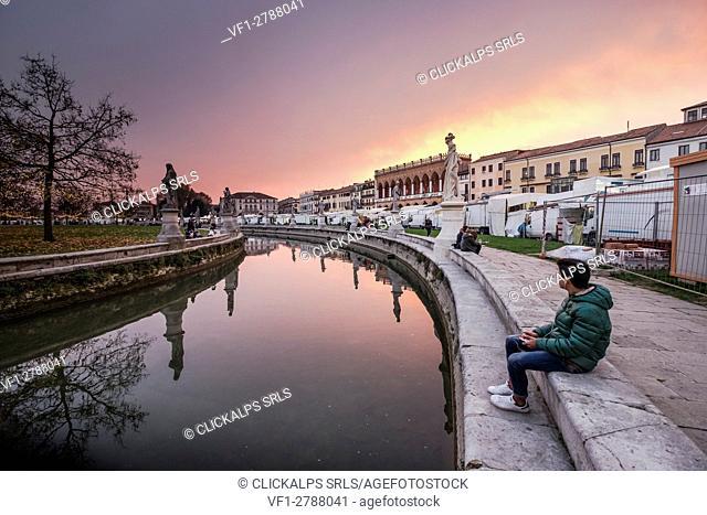 Padua, Veneto, North Italy, Europe. Relax in the Piazza Prato della Valle at dusk