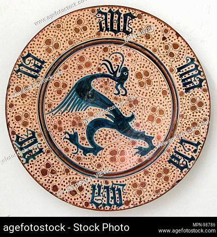 Plate with Dragon and Ave Maria Inscription. Date: 1425-1450; Geography: Made in probably Manises, Valencia, Spain; Culture: Spanish; Medium: Tin-glazed...