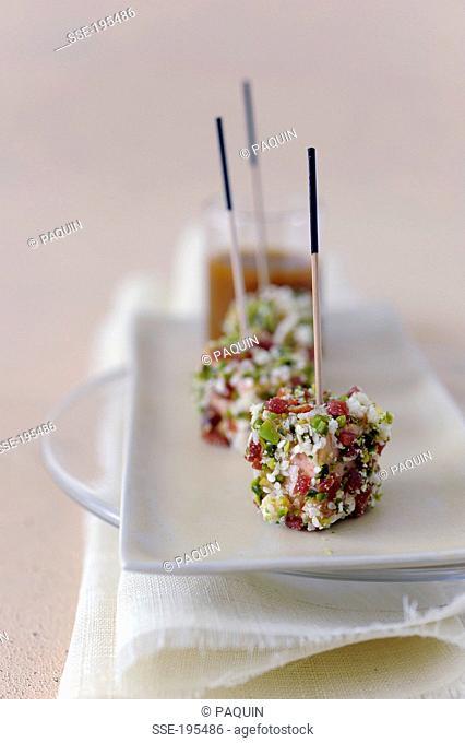 Foie gras,almond,raw ham and pistachio bites