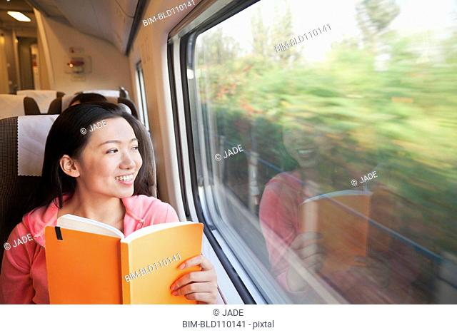 Chinese woman reading on train
