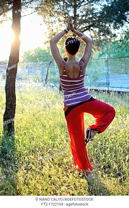 Young woman doing yoga in nature