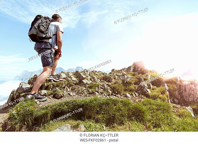 Austria, South Tyrol, hiker looking at view