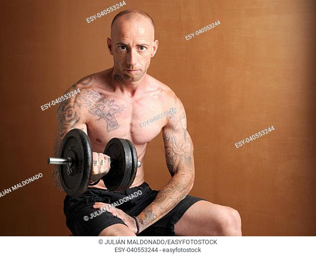 Young bodybuilder lifting weights