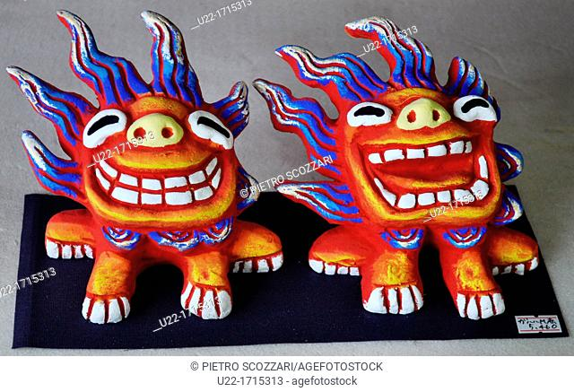 Ishigaki Island Okinawa, Japan: Shisa statuettes, made at Yoneko-yaki Pottery handicraft studio  Shisa is a traditional Ryukyuan decoration, often in pairs