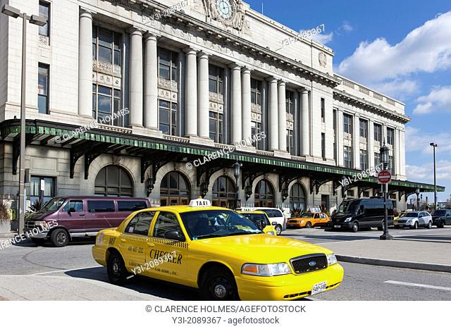 Taxis and other vehicles wait for passengers outside Pennsylvania Station in Baltimore, Maryland