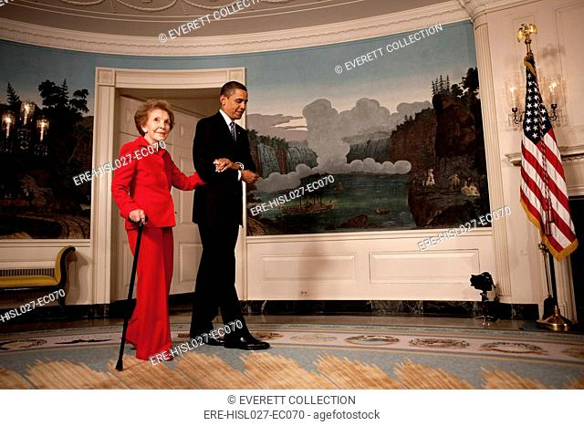President Obama escorts former First Lady Nancy Reagan to the signing of the Ronald Reagan Centennial Commission Act commemorating the late President's 100th...