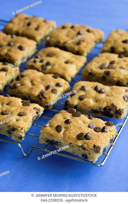 Chocolate chip cookie bars on a cooling rack