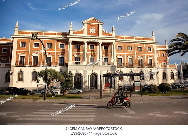 Motorcyclist in front of the Aduana-Custom Office building by the Atlantic Ocean, Cádiz City, Andalusia, Spain, Europe