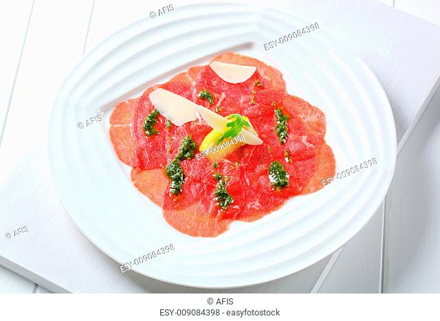 Beef Carpaccio with pesto sauce and shavings of Parmesan