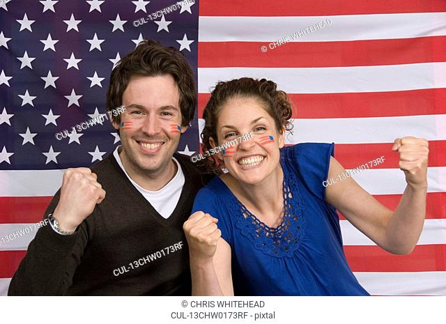 Couple smiling with American flag