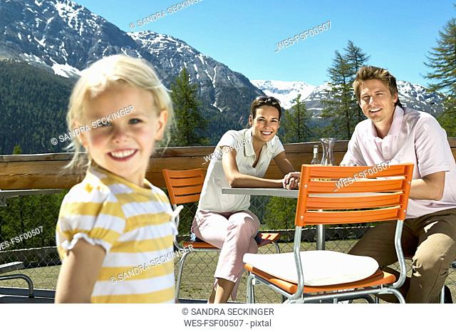 Happy family on panorama terrace in the mountains