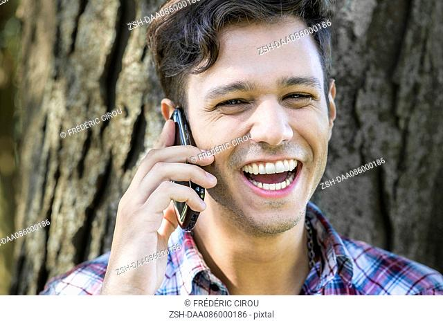 Man having lighthearted conversation on cell phone