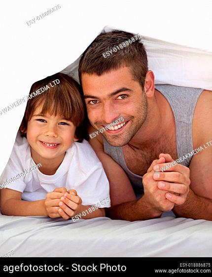 Father and son together under the bedsheets