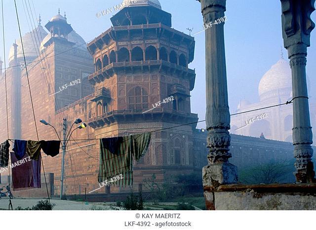 Clothesline with washing in front of Taj Mahal in the morning haze, Agra, Uttar Pradesh, India