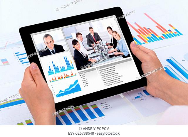Close-up Of Person Video Conferencing With Colleagues On Digital Tablet