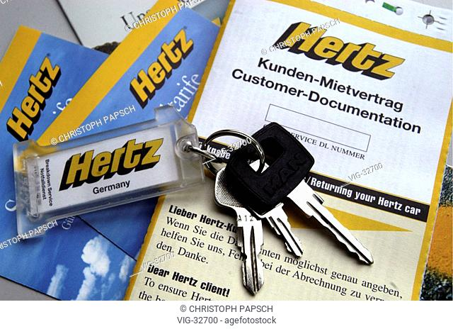 Car key with - Hertz - Germany - keychain, lying on a customers contract and scal of charges prospects. - BONN, GERMANY, 30/05/2003