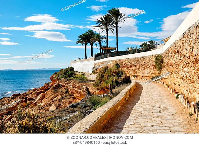 Paved promenade of Cabo Roig. Costa Blanca. Spain