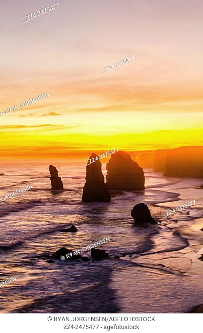 Setting sun on the Twelve Apostles orange cliffs along the Great Ocean Road in Victoria. Australia travel destinations