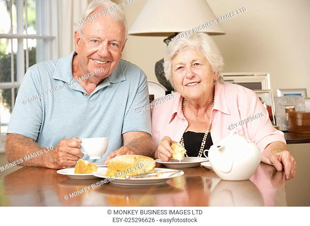Retired Senior Couple Enjoying Afternoon Tea Together At Home
