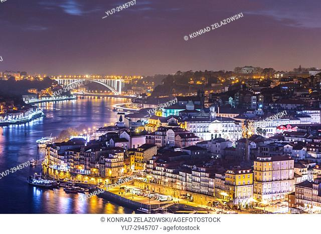 Aerial view on Douro River and Arrabida Bridge between cities of Porto and Vila Nova de Gaia, Portugal