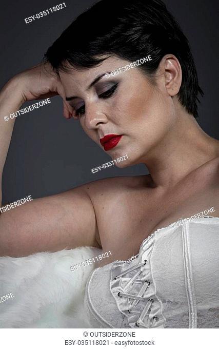 Sensual brunette woman in white lingerie