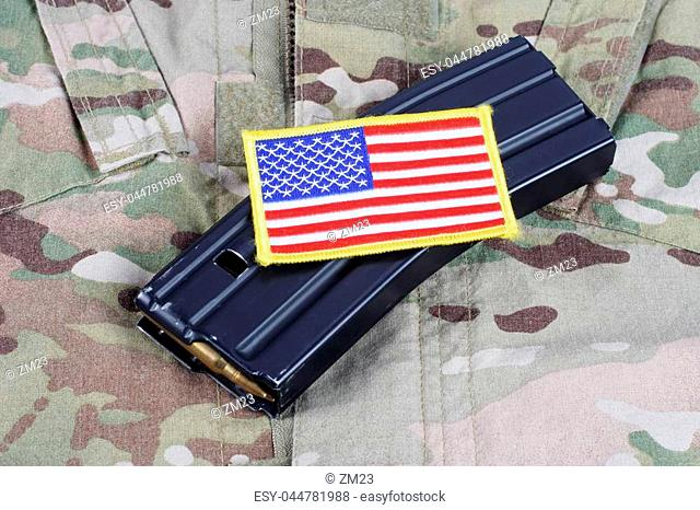 M-16 magazine with ammo on US Army uniform background