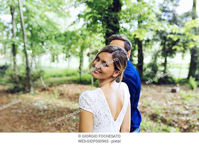Portrait of happy woman with her boyfriend in nature