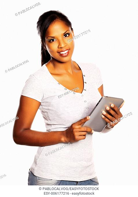 Portrait of a isolated young pretty black woman using a Tablet PC