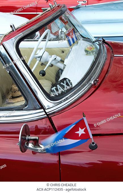 Classic american car with Cuban Flag, Havana, Cuba