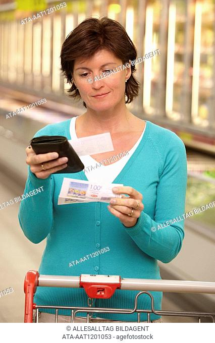 Woman looking at discount tickets