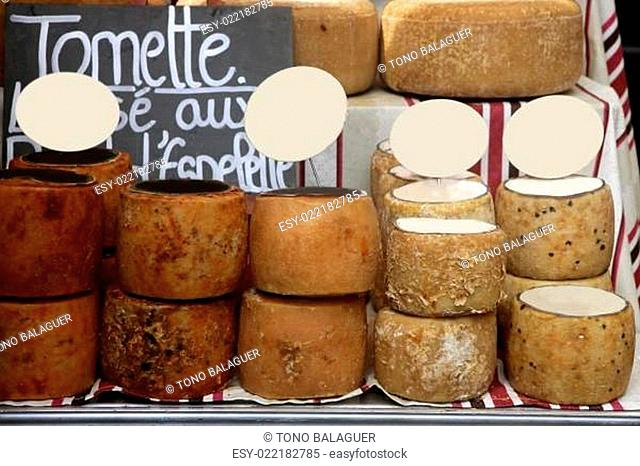 Aged french cheese wheels stacked