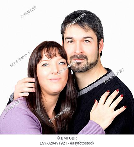 happy couple standing together against a white background