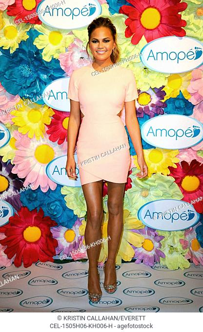 Chrissy Teigen (wearing an Elizabeth and James dress) at a public appearance for Chrissy Teigen and Amope Create Fairytale-Inspired Pedicure Stations for NYC...