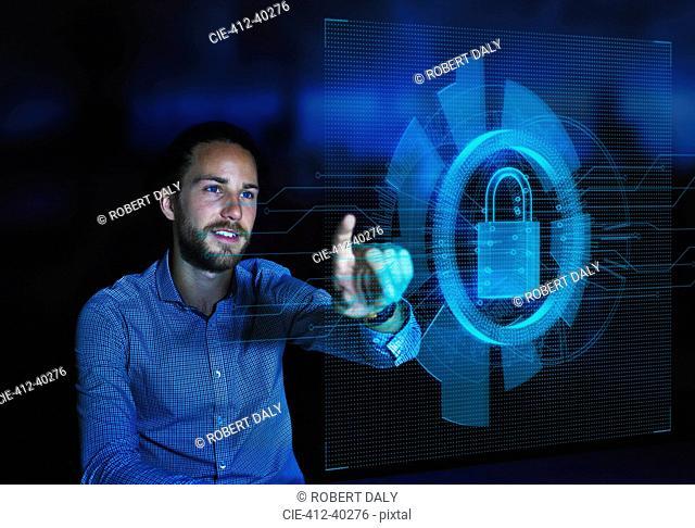 Businessman accessing security feature on futuristic hologram computer