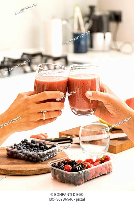 Friends making toast with smoothies