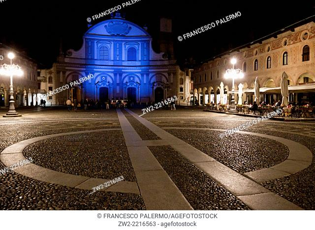 Blue light for autism day in a renaissance square. Vigevano, Lombardia. Italy