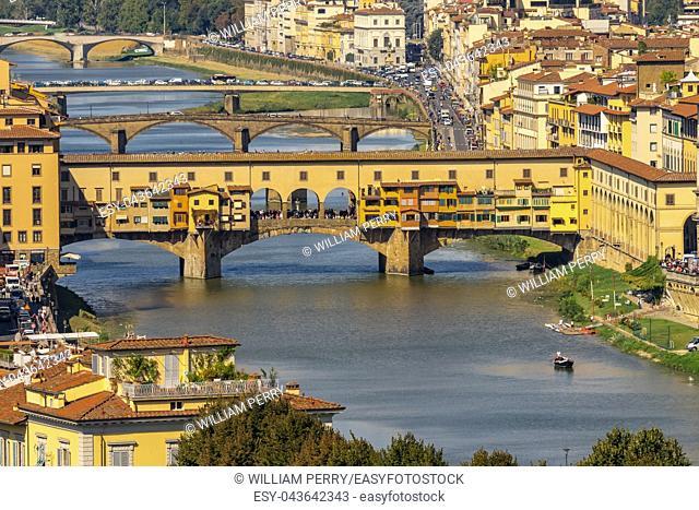 Ponte Vecchio Bridge Reflections Arno River Florence Tuscany Italy. Bridge originally built in Roman times, rebuilt in 1345
