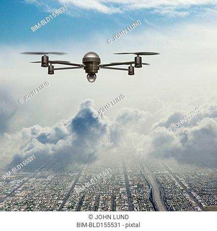 Drone surveillance plane flying over city