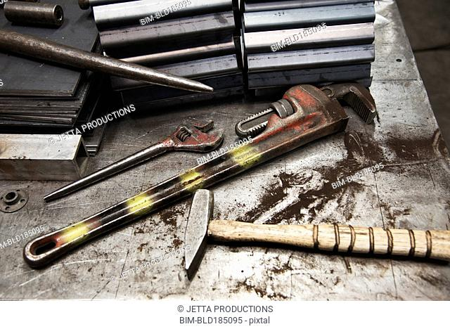 Tools on messy workbench