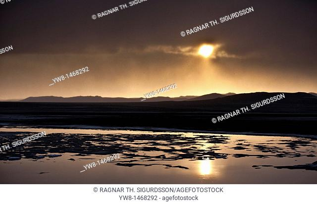 Sunset over glacial landscape, ash filled from the Grimsvotn volcanic eruption, Iceland  The eruption began on May 21, 2011 spewing tons of ash