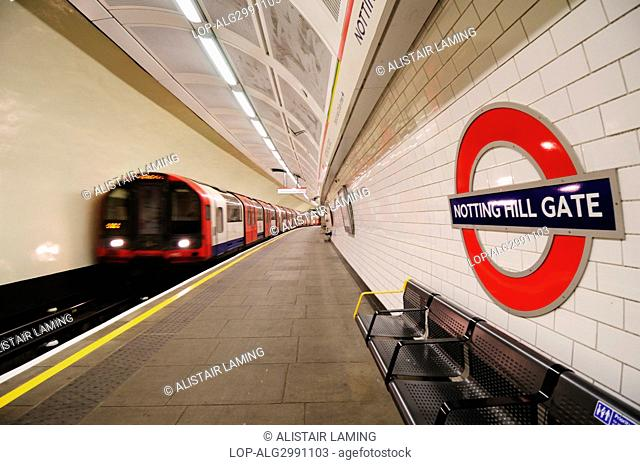 England, London, Notting Hill Gate. A Central line tube train departing Notting Hill Gate underground station