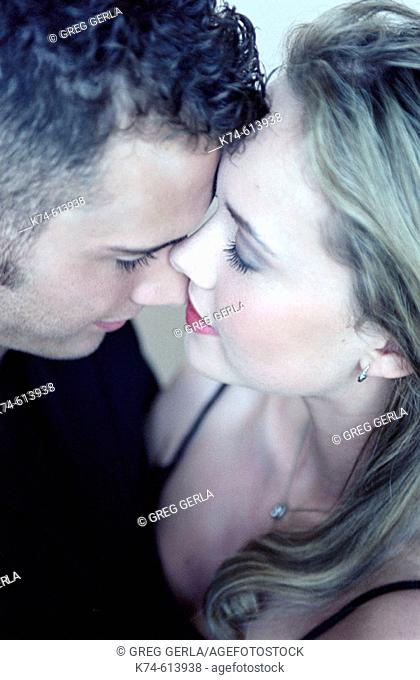 close up image of young couple embracing