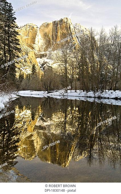Mountains reflecting in Merced River in winter, Yosemite National Park, USA