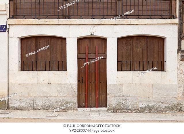 Peñafiel, Spain: Doorway in the Plaza del Coso with protective metal posts in place for the bullfight during the Fiestas de Nuestra Señora y San Roque