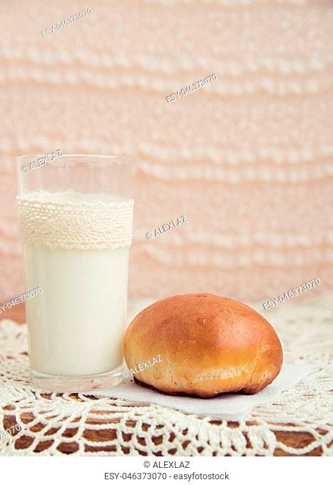 fresh pies with milk on light background