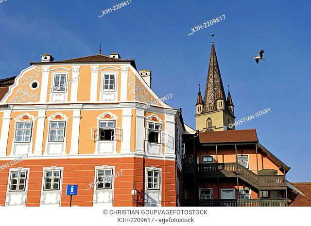 Luxemburg House with Evangelical Lutheran Cathedral bell tower in background, upper and old town, Sibiu, Transylvania, Romania, Southeastern and Central Europe